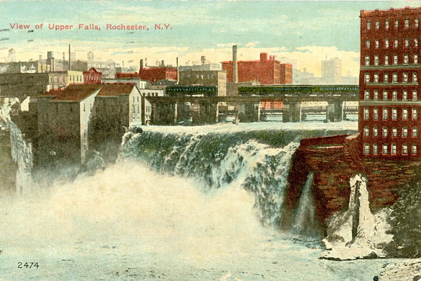 A view of Upper Falls (High Falls) of the Genesee River in downtown Rochester. The falls was the source of Rochester's flourmills and other industries in the 19th and 20th centuries. This particular postcard was mailed on November 13, 1918, during the city's influenza epidemic.