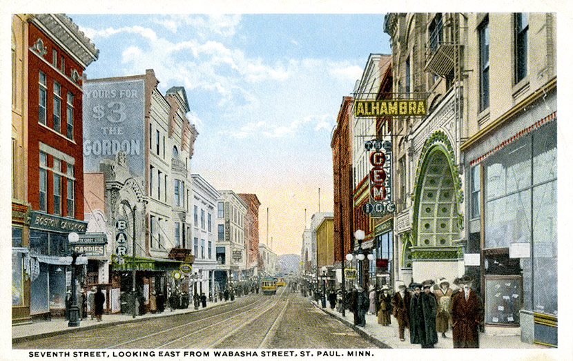 East 7th Street, looking east from Wabasha Street North. The Alhambra Theatre, located at 14 East 7 Street, can be seen on the right. The theater, which entertained up to 425 patrons per show, operated from 1911 to 1930. During the epidemic, public health officials closed the Alhambra and all other theaters and public entertainment venues in the city.