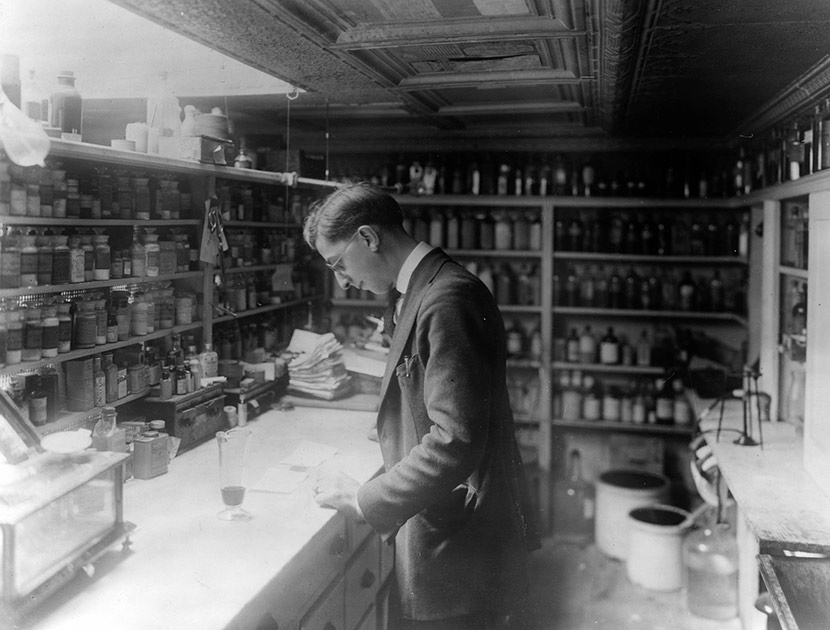 A pharmacist at People's Drug Store No. 5, at 8th and H Streets, NE, Washington, DC. During the epidemic, residents flocked to druggists to purchase a host of medications for influenza, many of them little more than snake-oil curatives.
