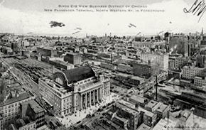Bird's-eye view of the Chicago business district, with the North Western Railroad passenger terminal in the foreground.