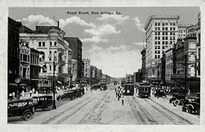 A view of Canal Street, the main thoroughfare in New Orleans and the original line dividing the older French and Spanish section of the city from the newer American section.