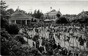 Crowded Children's Playground at Golden Gate Park in San Francisco, with the carousel and the Sharon Building in the background. With most indoor venues closed during the epidemic, parks and outdoor attractions became particularly important public places.