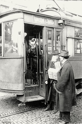 A Seattle Green Lake trolley conductor and passengers with flu masks, October 1918. A little over a year from when this photo was taken, a Green Lake trolley with more than 100 passengers aboard jumped the track, killing one and injuring 70 others. The Green Lake trolley line is now Green Lake Way North.