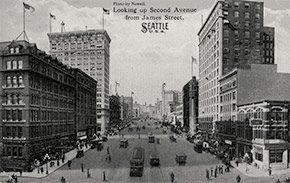 Busy 2nd Avenue in downtown Seattle, looking northwest from James Street. Many of these buildings are still standing today.