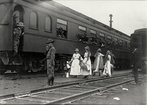 Men on troop train, with Red Cross workers in front. Scenes like this were common throughout the war period and during the epidemic.