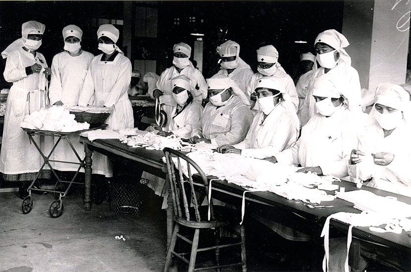 Boston Red Cross volunteers assemble gauze influenza masks for use at hard-hit Camp Devens, Massachusetts.