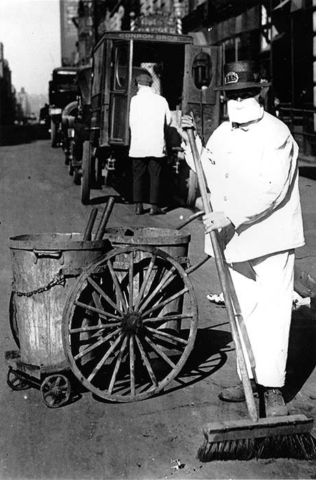 A New York City street sweeper wears a mask while on the job, October 1918.