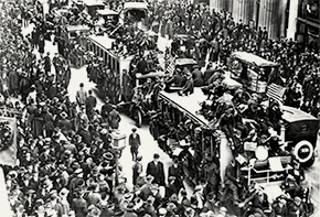 New Yorkers gather in the streets to celebrate Armistice Day, November 11, 1918. Public health officers across the nation feared that such large-scale gatherings would help continue to spread influenza, but knew that there was little they could do to try and stop them.