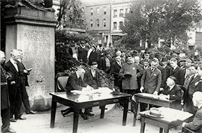 Open-air police court being held in Portsmouth Square, San Francisco. To prevent crowding indoors, judges held outdoor court sessions.
